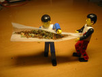 Lego men rolling a joint